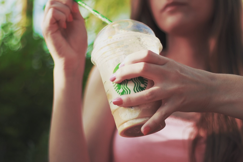 Woman drinking a frappe at Stansted's Starbucks